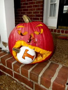 My husband and I's Alabama pumpkin... gnawing on the little UT one. ;)