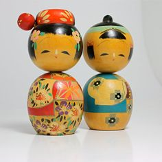 Kokeshi pair. Absolutely adorable. Wish they were in my collection!