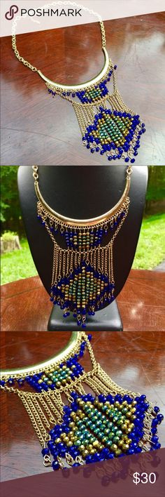 """Half Moon Beaded Statement Necklace Gold toned findings and chains with lots of faceted glass beads in royal blues and metallic colors all dangling off of the  half moon. This necklace is 19"""" with a 3"""" extender chain and the longest drop is 4"""" The Painted Jezebel Dezigns Jewelry Necklaces"""