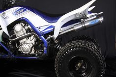 Barkers Dual Exhaust System on a Yamaha Raptor 700. Shown in Brushed Aluminum with Blue Barkers Tag #NeverSacrifice