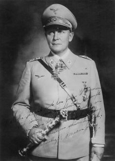 """The first official portrait of Herman Goering after he was created Reichsmarschall by Adolf Hitler. The photo, bearing a note in Goering's hand, was shot by Heinrich Hoffmann, Hitler's personal photographer, on July 19, 1940. Goering's figure is duly (and heavily) retouched to make him look thinner and more """"marshal-like."""" His baton can be seen at the West Point Museum."""