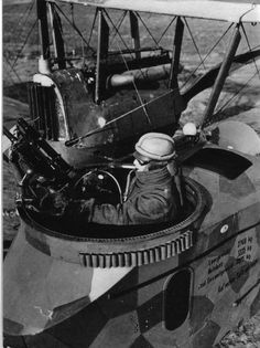 WWI;  German bomber gunner, dressed for high-altitude flight and sucking on an oxygen tube mans his machine gun. The plane is a Gotha G-IV bomber. Powered by two 260 horsepower engines, it could carry between 660-1100 pounds of bombs to a max. range of 305 miles.