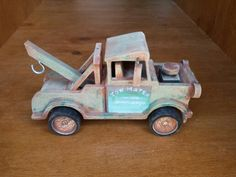 Churchie's homemade wooden Mater from cars, made of MDF using a scroll saw, pillar drill, and acrylic paints sanded down.