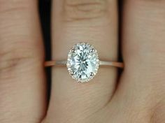 Oval diamond ring with halo and rose gold band. Gorgeous!
