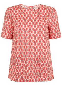 Orla Kiely Wallflower Top.  Red boxy top in certified 100% organic cotton. Flower print with short sleeve, front pockets and shell button fastening. Length 63cm.    Front pockets. Shell buttons.  Material: 100% Organic certified cotton  Length: Garment is 63cm long in size 12 (M)  Style Code: K501UNPK    How it's made: Made by CAOS, a socially responsible business based in India. CAOS, or Creative Art of Souls, produces a range of woven clothing for People Tree using organic and Fairtrade…