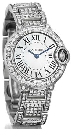 Cartier.    A Diamond and Gold 'Ballon Bleu' Lady's Wristwatch.  Of quartz movement, the silver opaline dial, with black Roman numerals and blue hands, with circular-cut diamond bezel and cabochon sapphire crown, to the pavé-set diamond links, mounted in 18K white gold, diameter 2 inches. Case and dial signed 'Cartier', case no.103905MX, with Swiss assay marks, with original box and papers. Philips de Pury.