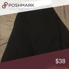 Black Lola skirt small Black Lola. Goes to the knees. Slip underneath is black with black chiffon type fabric over. White waistband. Worn once. Washed once per standards. LuLaRoe Skirts Midi