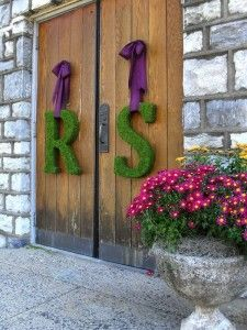 Moss letters w/ ribbon -- maybe not moss, but definitely giant initials.