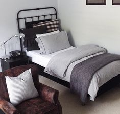 Teenage Boys Bedroom | Industrial Boys Room | Aged Leather Arm Chair | Black & White Ticking | Check Plaid Linen | Wrought Iron Bed