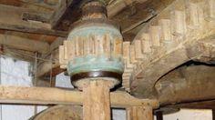 Giant gear wheels interlocking inside Bembridge Mill, Isle of Wight