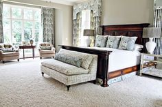 Master bedroom with sitting areas: love the settee at the end of the bed.