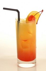 Hawaiian Sunrise cocktail      2 oz Coconut rum (Parrot Bay)     1/2 oz Absolut Mandrin     7 oz Pineapple juice (Dole)     1 splash Grenadine (Rose's)    Pour in rum, then vodka follow with Pineapple juice. Drop in grenadine last - let settle for a sunrise effect.  ganish with cherrry & pineapple wedge
