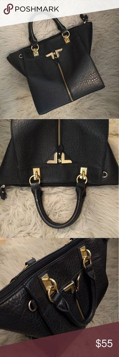 ✨Black Satchel with Gold Detail✨ ➡️Description: Gorgeous black satchel with gold hardware.  Top zipper. With grey interior and 3 pockets. Front outside pocket with gold zipper.   ➡️Measurements:               Length:  10 Inches (as shown)               Width:  approx 7 Inches (as shown)               Hieght: 10 inches (as shown)               Zipper Length: 16inches  ➡️If you have any questions please feel free to let me know!  ❤️Thanks for stopping by!❤️ Danielle Nicole Bags
