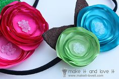 These satin flowers are super easy to make.  And they look adorable.  I put some on hair clips instead of headbands though...and without the felt leaves.