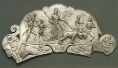 Handle of dish with depicting of the Indian triumph of Bacchus.  Silver, gilding. 3rd century A.D. Length 22.7 cm; weight 672.7 g. Inv. No. 54.11.8. New York, the Metropolitan Museum of Art.