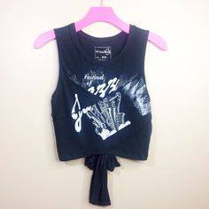 FREE PEOPLE Cool Rider Crop Tank This fun FREE PEOPLE crop tank has a crew neckline, graphic detailing at the front and a keyhole tie back. Color: BLACK || Size: MEDIUM || 100% cotton || Imported || This item is NEW WITH TAGS Free People Tops Crop Tops