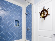 I really love the color of the blue tile - and the fact that it is outlined in whit gives it a whole new look. Love tiling on diamonds, too.