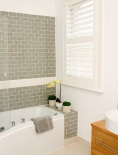 Bathtub with shelf at back. Nice Smoke Grey Glass subway tiles. https://www.subwaytileoutlet.com/products/Smoke-Glass-Subway-Tile.html#.VH98J_nF-1U