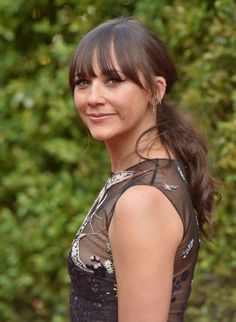 Rashida Jones's long bangs and low pony show the best part about medium length hair: you can totally pull off a low ponytail. Extra points for giant, flaw-free bangs.