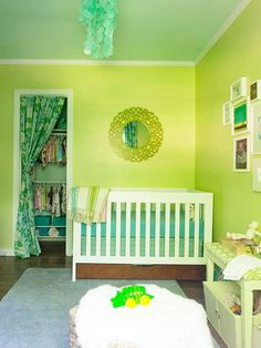 Paint Picks - This room, from John and Sherry Petersik of younghouselove.com, boasts a gender-neutral scheme with a green base, pops of pink accents, and a bit of floral fabric. The pear-green walls are cheerful without being overpowering. The light aqua ceiling feels like you're staring up at the clear blue sky.