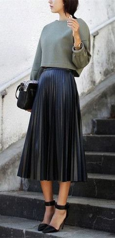 Loose Top & Navy Pleated Skirt.