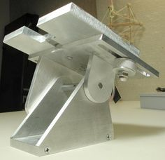 Homemade adjustable tool rest machined from aluminum and intended for use with a bench grinder.