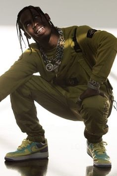 "Travis Scott wearing  Stone Island House Check Sweater, Stone Island Mussola Gommata Pants, Nike Air Force 1 ""Easter"""
