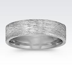A brushed finish gives this men's wedding band a bold look. #ShaneCo