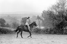 """September 25, 1962: First Lady Jacqueline Kennedy rides her horse, """"Sardar,"""" on the grounds of Glen Ora in Middleburg, Virginia. Photographed by Robert Knudsen."""