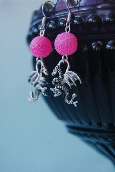 Silver dragon earrings with pink frosted agate by otterlydesign, $17.99    These earrings are perfect for any dragon or fantasy enthusiast! The detailed silver dragon charm is dangling from a hot pink frosted dragon veins agate bead looking, making for a very decorative pair of earrings. Why not put them on for your fifth viewing of The Hobbit, or a whole bunch of episodes of Game of Thrones?!