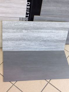 Silver travertine walls and grey tile floor