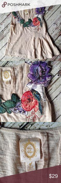 Anthropologic Ric Rac top Cotton top with appliqué flower design at neck line, asymmetric bottom. Anthropologie Tops