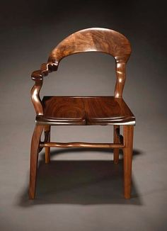 Chair carved from beautiful black walnut. Size is 21 inches wide, 21 inches deep, 33 1/2 inches tall.  By Danny Kamerath.