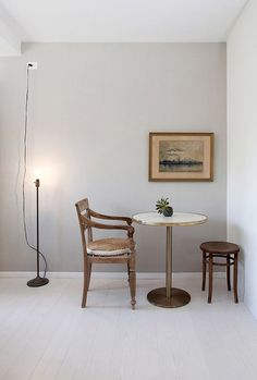 vintage seascape in simple dining area. / sfgirlbybay