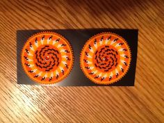 "2 3/4"" medallions swirling baskets. Orange and light orange background. 11/0 cuts. November 2014 Scott Sutton"