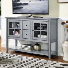 TV stands don't just belong in the dining room or parlor—use this wood design to keep your collection of leather-bounds safe and in-view beside your study desk, or arrange DVDs and other entertainment accessories in the den among framed photos and cherished souvenirs.
