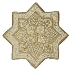 KASHAN LUSTRE POTTERY STAR TILE  CENTRAL IRAN, DATED AH 670/1271-2 AD  8¼in. (20.8cm.) across  I Christie's
