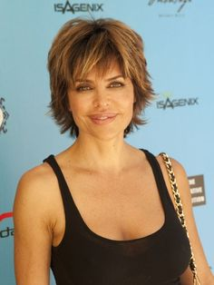"Lisa Rinna  ~Lisa put the ""BANG"" in bangs! An all-over choppy cut with wisped ends adds instant volume."