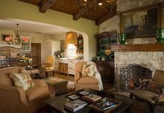 Vintage hardwood plank floors, heavy timber beams and a stone fireplace create the feel of a  European farmhouse.