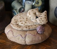 Primitive Napping Kitty Pincushion E PATTERN -- I have bought this pattern --- haven't made it yet but will have to now --- it really is so cute!