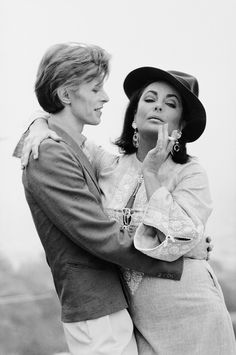 vanityfair:  David Bowie meeting Elizabeth Taylor for the first time in 1975.  Photograph by Terry O'Neill.