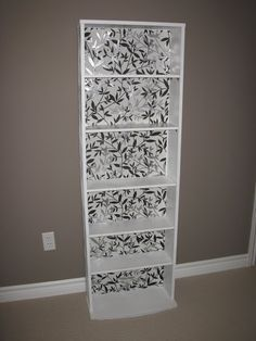 Paint and wallpaper a particle board bookshelf | Ramblings of an Indecisive Mind