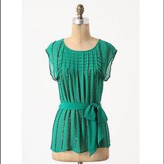 """Anthropologie Glimmer Graph Top  Beautiful blouse from Carnation Lily Lily Rose for Anthropologie. Sheer silk shimmers with sequin stripes and mercurial beading, nipped at the waist with a solid sash. Beautiful emerald green color with black beading. Sheer silk fabric. Style No. 23106651. 27.75"""" long. Loose, easy fit. Worn once and just dry cleaned; no noticeable beading missing as is expected with this delicate type of shirt. In excellent condition! Bundle & save ! Sorry -  trades…"""