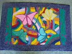 taken from a picture my daughter drew many years ago. approx. 2x3', mixed fabric, punched using Rug Crafters tool, made by Carmen Hall finished Oct 2015