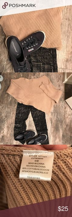 Short and sweet Tan colored comfy sweater. Short crop top style with a slant at the bottom. Unique shorter on one side than the other, slant style! Cute with a pair of leggings as in the picture or can be paired with a hott little skirt for a night out. No pulls or stains! Only worn once. Fashion Nova Sweaters Crew & Scoop Necks