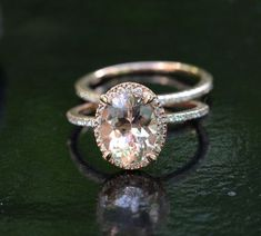 14k Rose Gold 9x7mm Morganite Oval Engagement by Twoperidotbirds   i like how the bands are so thin that it give the ring a lighter and not so in-your-face look