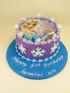 Chocolate and Vanilla Marble cake with chocolate ganache and covered in fondant. Elsa is an edible wafer paper image.