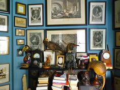 Blue walls - a hard color to work with unless you cover the majority with other items.  Love this...