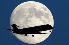 "HARVEST MOON COMING  | An airplane passes a nearly full moon as it makes its approach to Philadelphia International Airport, Sunday, Sept. 7, 2014. Monday night's full moon, also known as a Harvest Moon, will be the third and final  ""supermoon""  of 2014. The phenomenon, which scientists call a ""perigee moon,"" occurs when the moon is near the horizon and appears larger and brighter than other full moons. AP Photo/Matt Rourke"