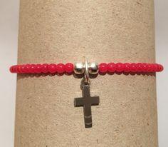 Pulsera color rojo con cruz